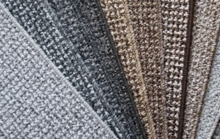 A fanned out variety of commercial carpet options.